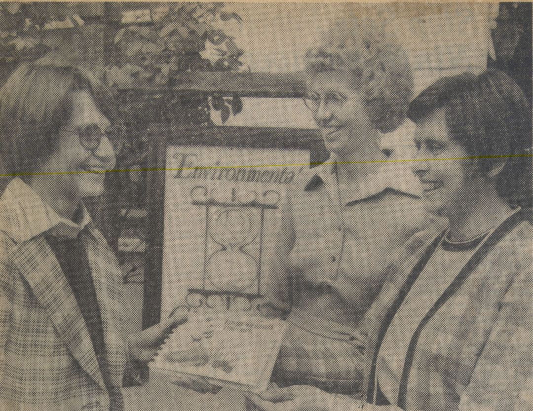 1976: Environmental Trip Tips presented to Deborah Botch of the YWCA by ECOS President Beverly Kingsley and ECOS Director Claire Schmitt.